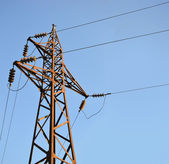 Old high voltage post with blue sky — Stock Photo