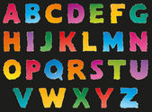 Vector alphabet from torn scraps of colored paper — Stock Vector
