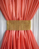 Coral curtain ruffled gold belt — Stock Photo