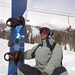 Snowboarder sitting — Stock Photo