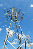 Two electricity pylons — Stockfoto