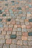 Ett fragment av stenen trottoaren — Stockfoto