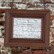 Wood frame on brick wall - Stock Photo