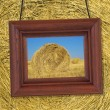 Wooden frame on the background of hay — Stock Photo
