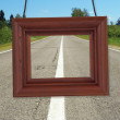 Wooden frame on background of road — Stockfoto #19913315