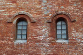 Brick wall and two windows — Stock Photo