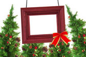 Photographic frame and Christmas trees — Stock Photo