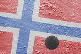 Norwegian flag and the puck on the ice — Stock Photo