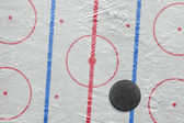 Puck on a hockey rink — Photo