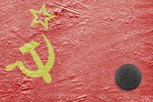 Flag of the Soviet Union and puck on ice — Stock Photo