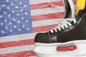Hockey skates and American flag — Photo