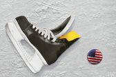 Hockey skates and puck — Stock Photo