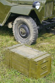 Military vehicles and wooden box  — Foto Stock
