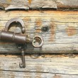 Old mechanical lock and wooden wall — Stock Photo #47768621