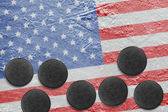 American flag and washers on the ice  — Stock Photo