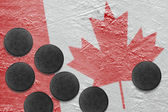 Canadian flag and washers on the ice — Stock Photo