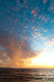 Clouds at sunset over Pacific ocean — Foto Stock