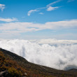 Clouds beneath the top of the mountain — Stock Photo
