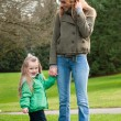 Stock Photo: Young mother and toddler daughter at the park