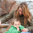 Stock Photo: Centred little girl with mother waiting