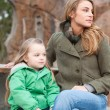 Stock Photo: Mother and daughter resting on a bench