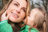 Woman listnening her daugther with smile — Stock Photo