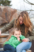 Centred little girl with mother waiting — Stock Photo