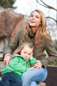 Smiling young woman with daughter — Stock Photo