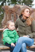 Mother and daughter resting on a bench — Stock Photo