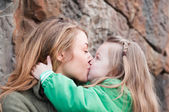 Kissing mother and daughter — Stock Photo