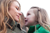 Eye-to-eye contact of girl and her mom — Stock Photo