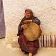 Tunisian woman plays the drum — Stock Photo