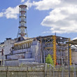 Chernobyl Nuclear Power Plant on the river Pripyat — Stock Photo #15272277