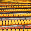 Bright yellow and blue seats in rows — Stockfoto