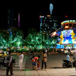 Are walking at night on January, 18 in Ho Chi Minh City, Vietnam — Stock Photo #18111371