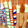 Handmade wool socks hanging on clothesline — Stock Photo #18115989