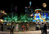 Are walking at night on January, 18 in Ho Chi Minh City, Vietnam — Stock Photo