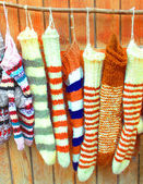 Handmade wool socks hanging on a clothesline — Stock Photo