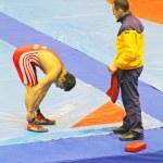 KYIV, UKRAINE - FEBRUARY 16: Arsen Yedigarov (Ukraine) rests with his coach during 19 International Tournament in wrestling February 16, 2013 in Kyiv, Ukraine — Stock Photo #21598475