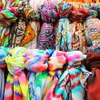Rows of colourful silk scarfs hanging at a market stall in Tossa — Foto de Stock