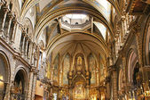 Interior of Basilica in Benedictine Abbey of Santa Maria de Montserrat (founded in 1025) in Montserrat, Spain. Millions of pilgrims visit abbey every year — Stock Photo