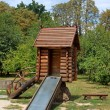 Childrens wooden playhouse with slide — Stock Photo #41573195