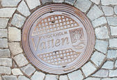 Sewer manhole in Stockholm, Sweden — Stok fotoğraf