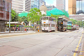 Unidentified people are using city trams in Hong Kong — Stock Photo