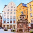 Old well on Stortorget square, a small public square in Gamla Stan, the old town in central Stockholm, Sweden — Stock Photo