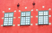 Windows of red iconic buildings on Stortorget, a small public square in Gamla Stan, the old town in central Stockholm, Sweden — Stock Photo
