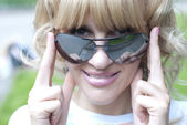 Young lady wearing sunglasses — Stock Photo