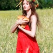 Stock Photo: Girl with bread in field