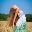 Long-haired girl in wheat field — Stock Photo