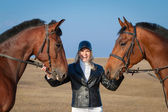 Horsewoman and two horses — Stock Photo